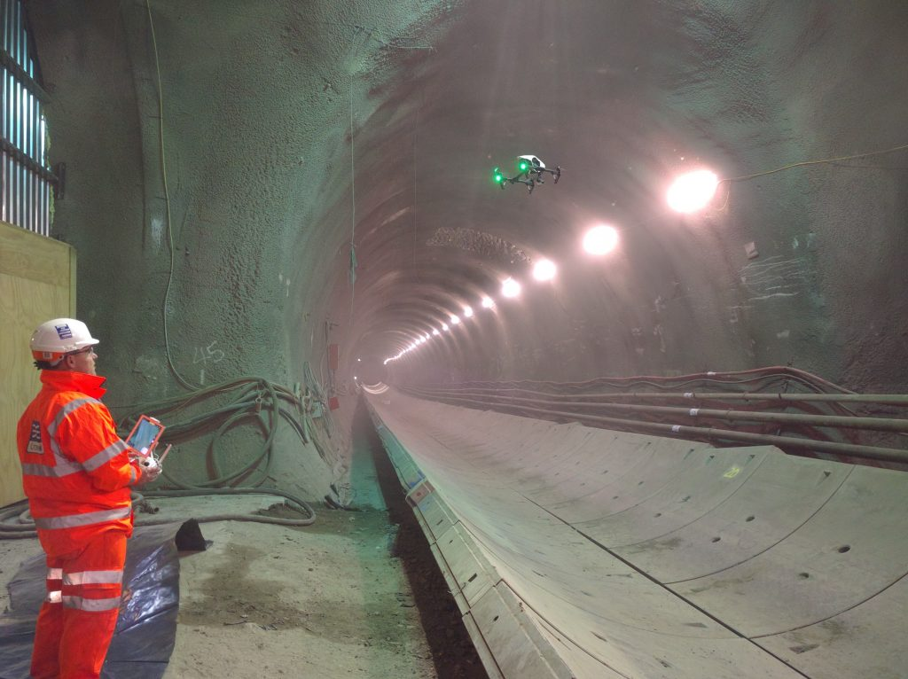 Crossrail engineer using airborne drone in a tunnel