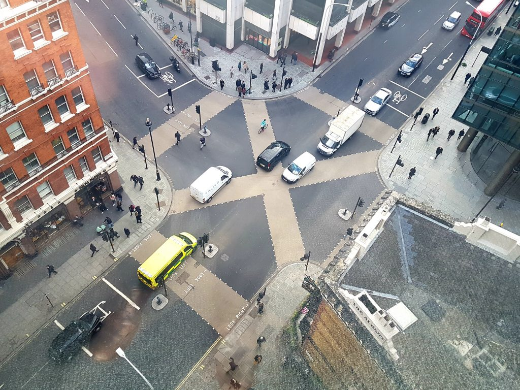 an X-shaped pedestrian crossing viewed from the tenth floor of a nearby building