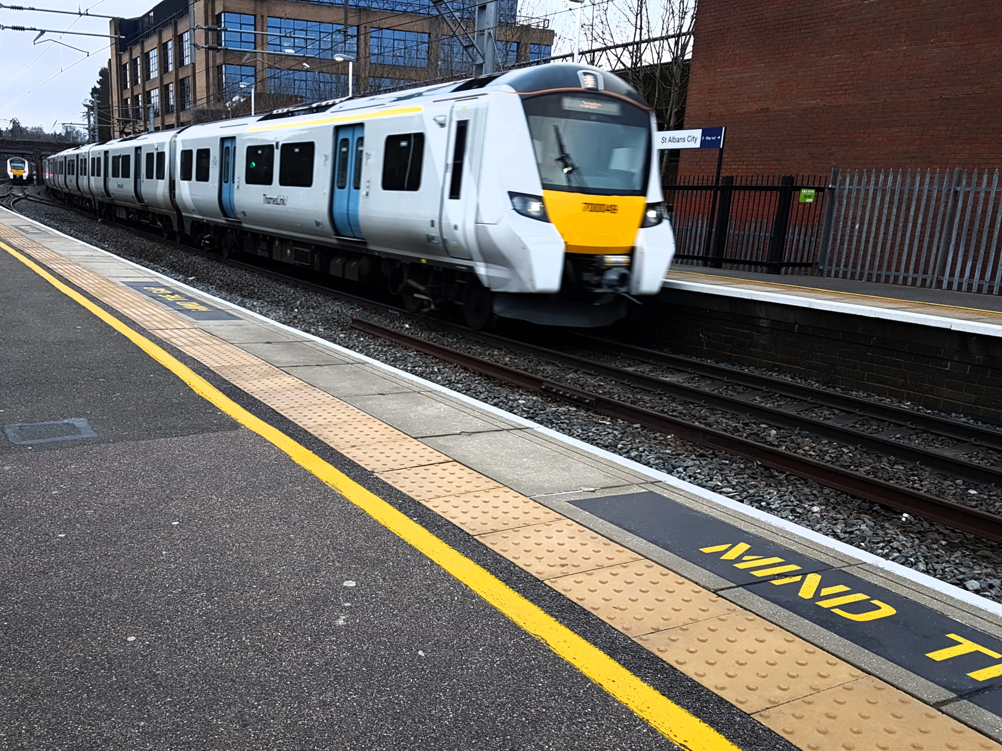 a Thameslink train arriving into a station